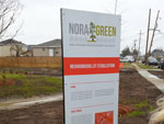 Signage for the Filmore Gardens NORA Green Pilot Rain Garden Program.