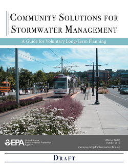 This is a decorative photo showing thumbnail image of the front page of the draft guide with a photo of green infrastructure around people at a light rail station.