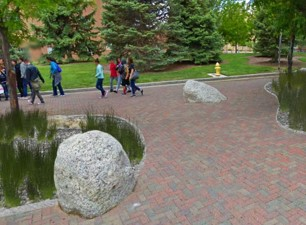 Artistic rendering of bioretention, permeable pavers, and decorative boulders on University of New Mexico campus.