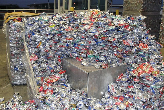 This is a picture of many aluminum cans, all of which are flattened.