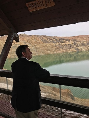 Photo of EPA Senior Adviser Albert Kelly viewing the expanse of the Berkeley Pit located in Butte, MT. His visit to the Anaconda and Butte / Silver Bow Creek Superfund sites highlights EPA's commitment to moving forward with expedited clean ups.