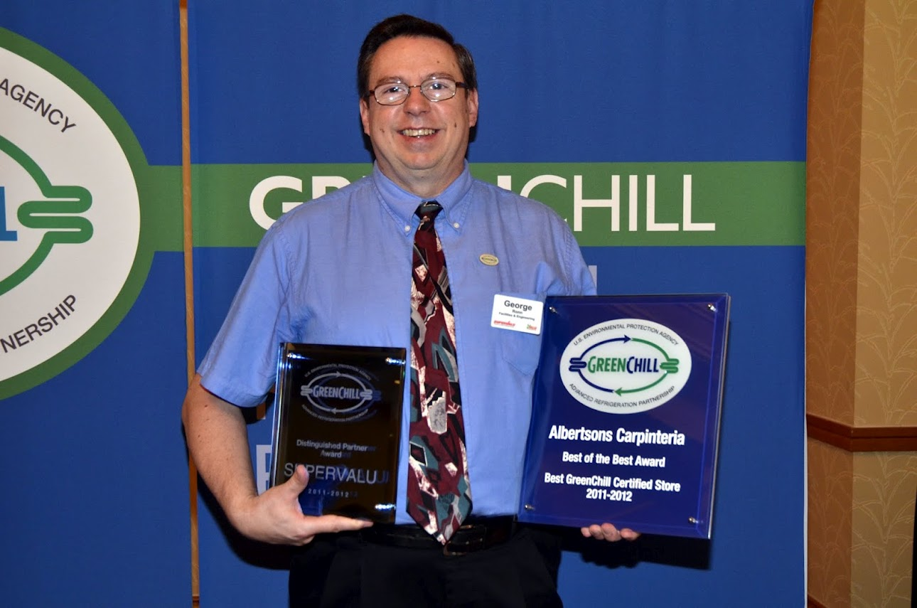 George Ronn from SUPERVALU accepts two awards from GreenChill for being a Distinguished Partner and for having the best GreenChill-certified store of the year