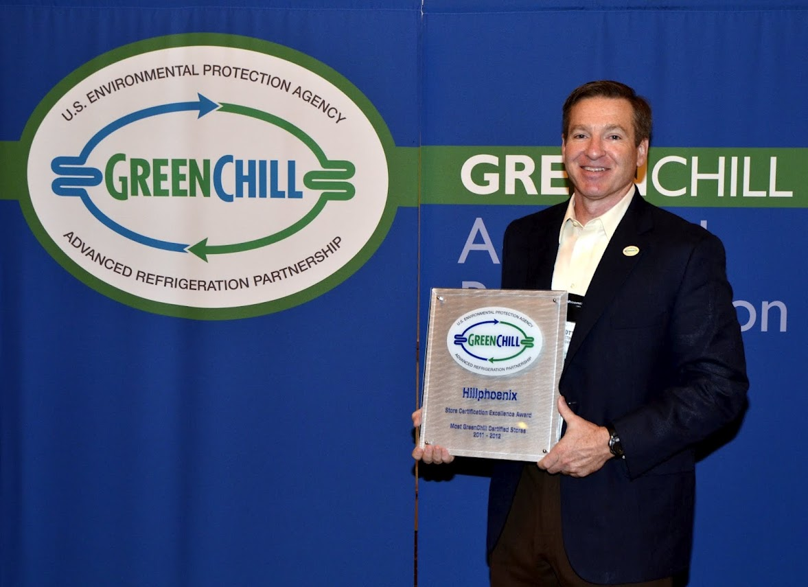 Scott Martin from Hillphoenix accepts an award from GreenChill for manufacturing systems for the largest number of GreenChill-certified store this year