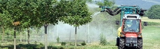 image of tractor spraying trees