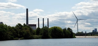 A view of the Mystic River with a power plant in the background.