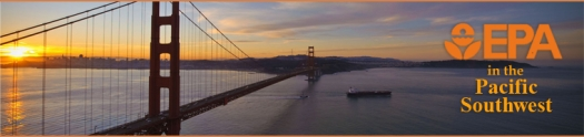 Image of the Golden Gate Bridge at sunrise with a ship passing beneath