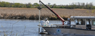 Scientists take sediment samples of the Zephyr site on the Mudpuppy II, EPA's sampling vessel.