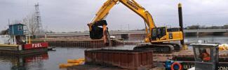 Excavating Marinette WPSC sediment from a barge