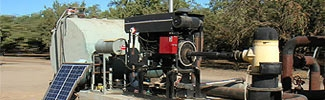 Picture of a large stationary engine providing power to an agricultural operation
