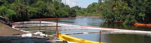 oil containment boom deployed on river