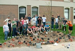 Group Photo on a pile of empty flower pots at project completion