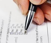 Image showing someone using a pen to cross items off of a checklist