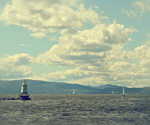 Scenic view of Lake Champlain with a lighthouse in the foreground