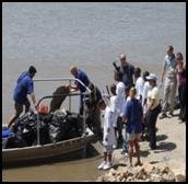 Former Administrator Jackson, EPA staff, and children from the Blue River Watershed Association at a cleanup in 2009