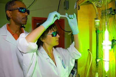 Ms. Amy Zhao and Dr. Endalkachew Sahle-demessie withdraw sample material to test effects of Ultra Violet light and zero valance iron on Perchlorate concentration in water.