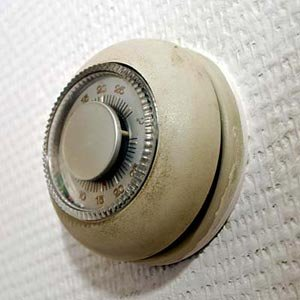 old-fashioned round thermostat, the kind that contains mercury