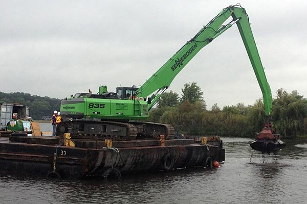 Construction crew removes contaminated sediment from White Lake.