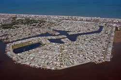 Photograph of a dense coastal community - habitat loss through land use conversion. Photo credit: Andy Serrell