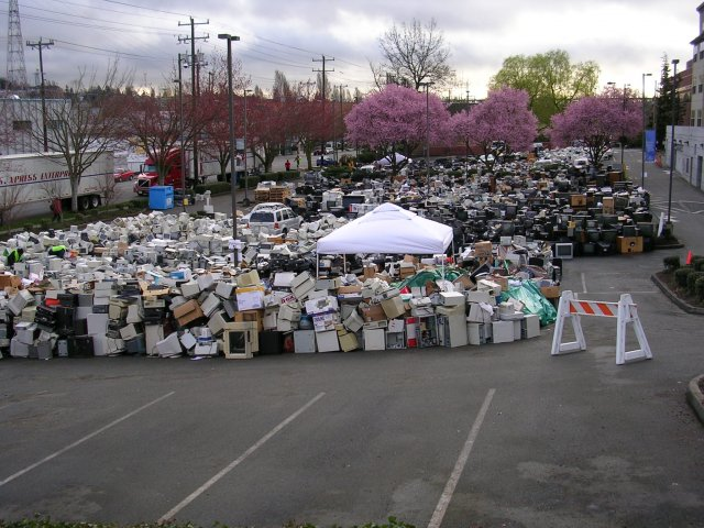 This image is of a parking lot filled with electronics--especially monitors with cathode ray tube  that were collected for recycling in 2008. Thousands of electronics are shown in the photograph.