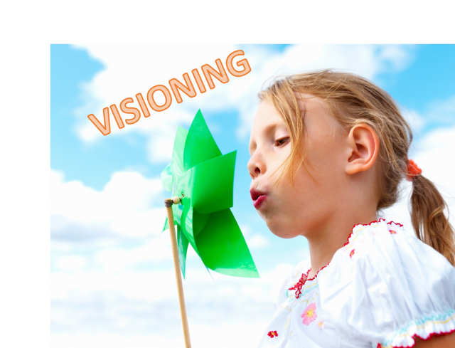 Visioning - A little girl blowing a pinwheel