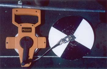 Secchi Disk: A flat, circular disk with high-contrast black and white paint alternating to increase visibility attached to a measuring cable.
