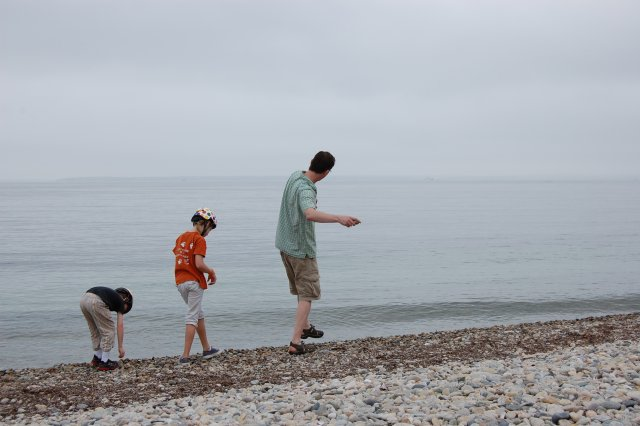 Mike Tryby and his two kids play on a beach