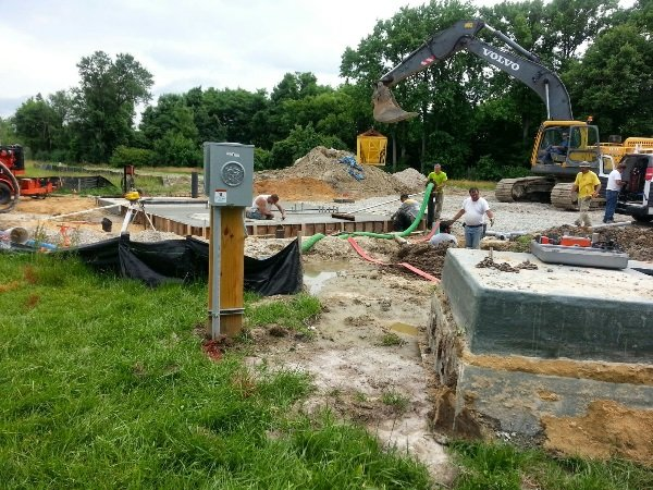 Workers help ready new sewer system.