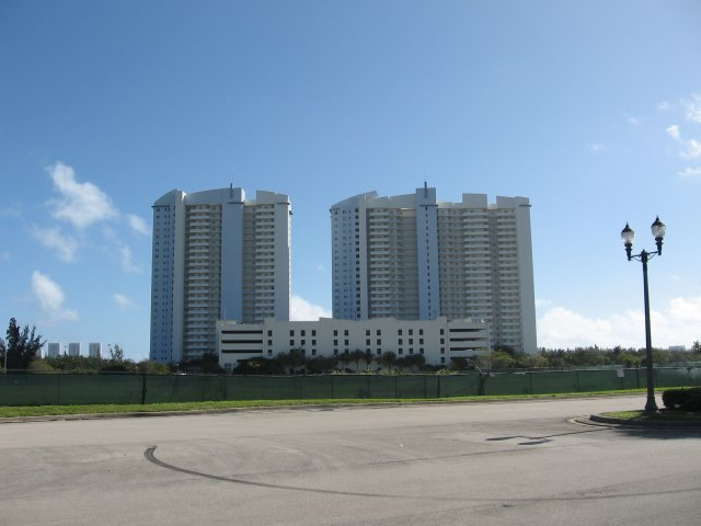 The two residential towers and parking at the site