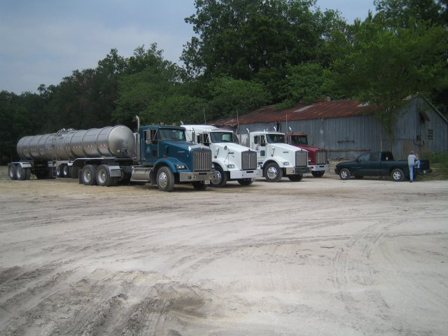 Water transport trucks at the site, and the utilities building