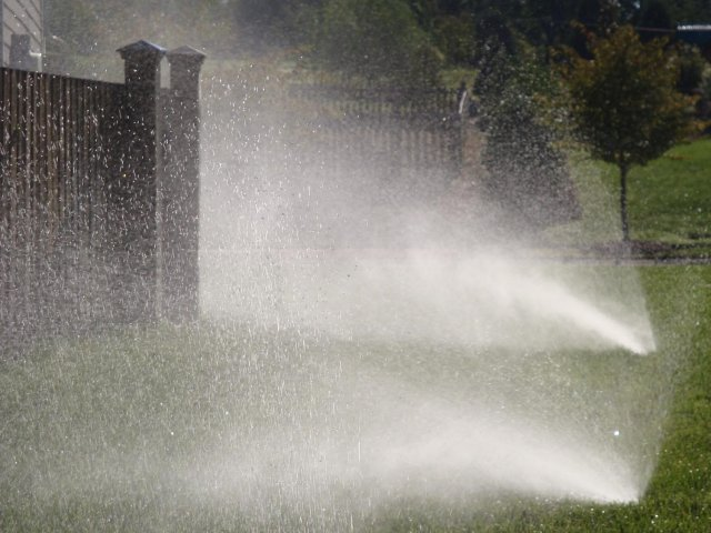 High pressure sprinkler being used on a yard