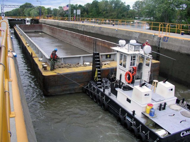 The tugboats and barges had to navigate through the lock system to get to the processing facility. The barges made as many as 20 one-way trips to and from the processing facility during a 24-hour period.