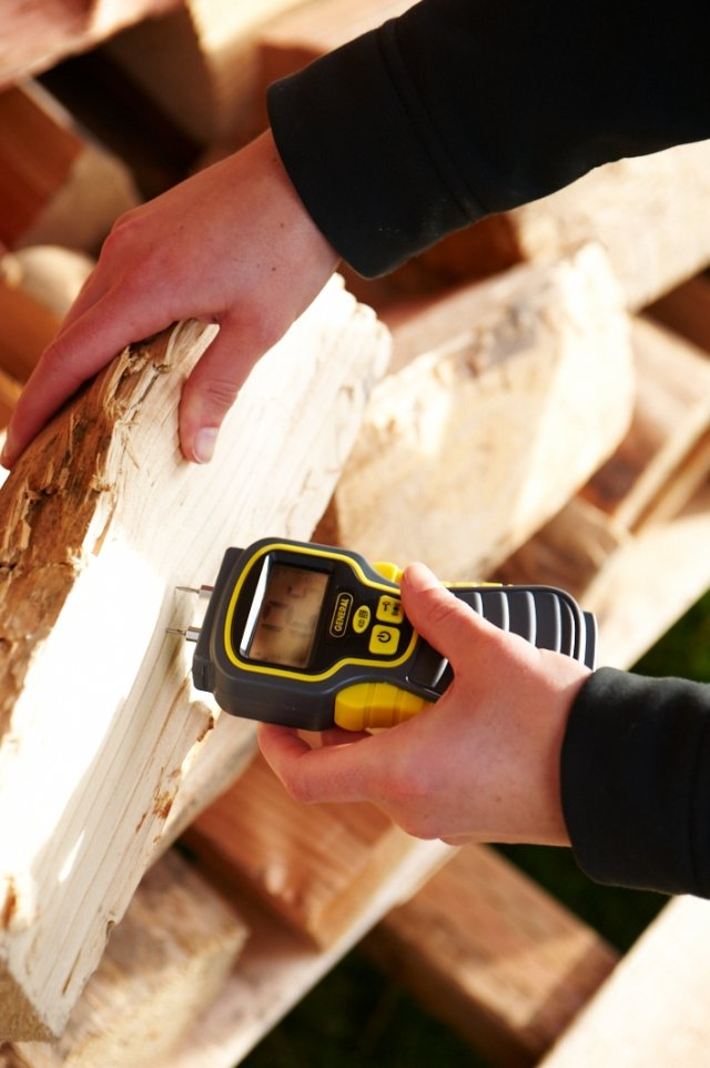 Testing firewood with a moisture meter