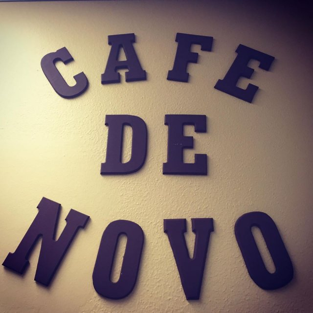 This is a picture of a sign that says Cafe de Novo