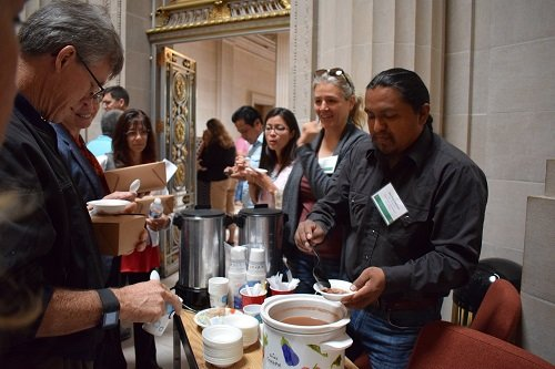 Man serving beans to attendees of the 2017 Local Foods, Local Places Summit