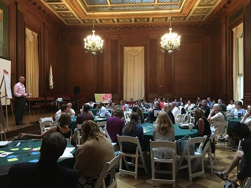 People listening to speaker at 2017 Local Foods, Local Places Summit