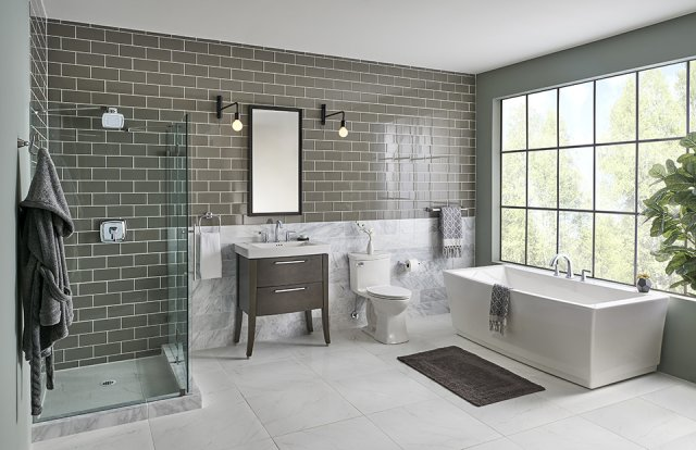 Tiled bathroom with a large window.