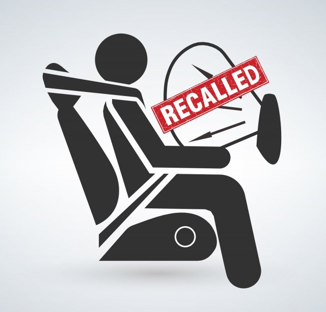 This is a drawing of a person sitting in a car with an inflated airbag with the word Recalled over the airbag.