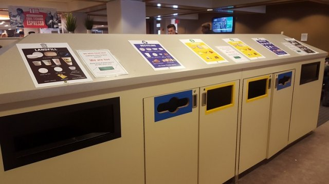 This is a picture of the trash, recycling and composting bins at Boston College.
