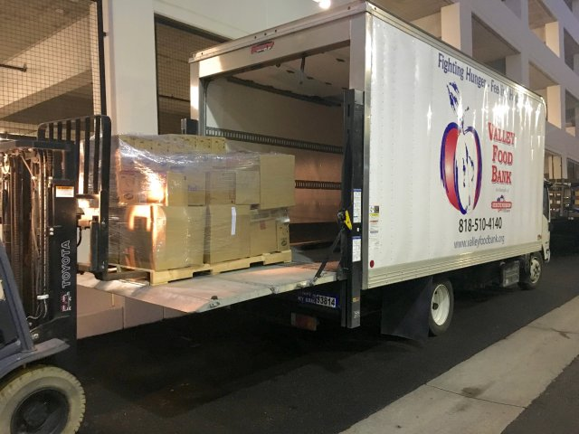 This is a picture of a donation truck being loaded.