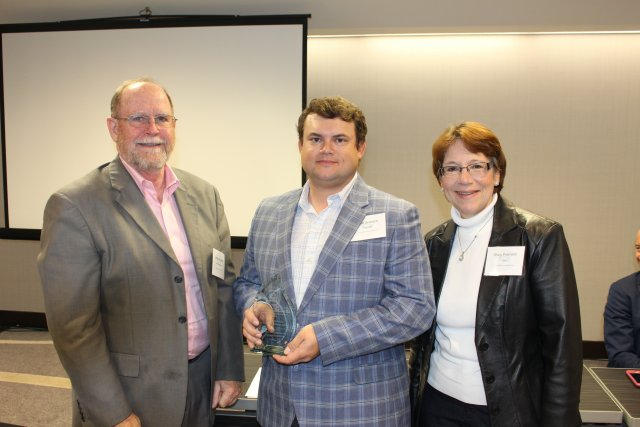 EPA's Jim Woolford (left) and Region 7 Superfund Division Director Mary Peterson (right) with IDNR award recipient Matt Graesch
