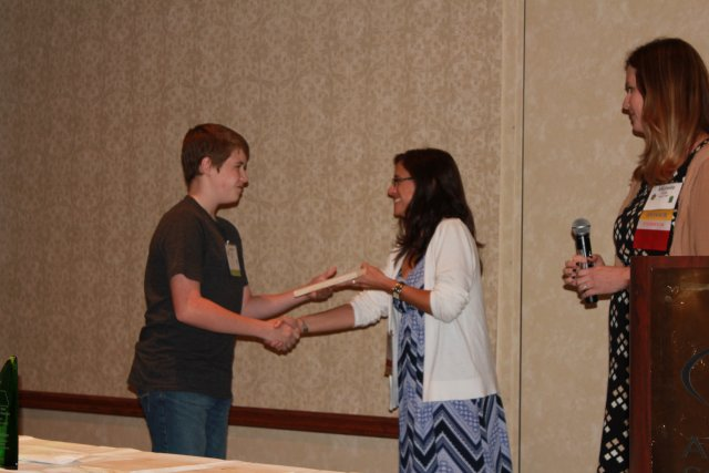 This is a picture of a student receiving an award