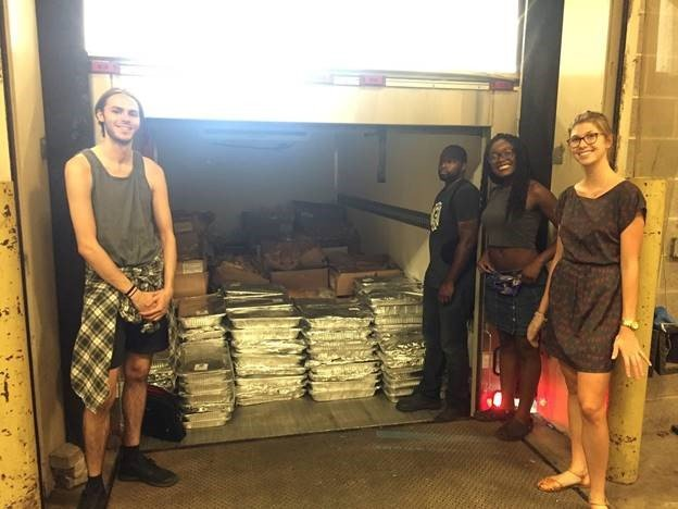This is a picture of student loading a truck of food donations.
