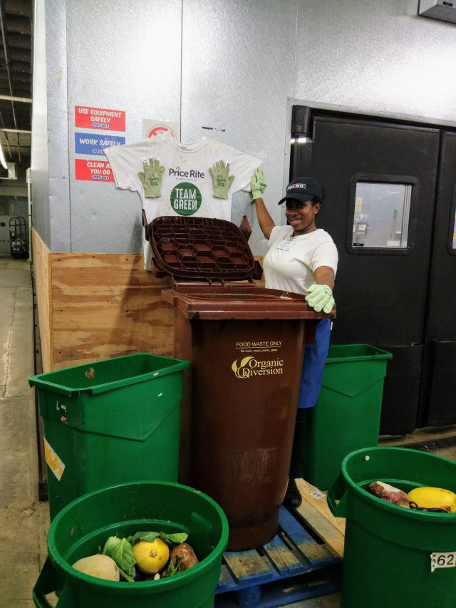 This is a picture of a worker composting at a Ravitz supermarket.