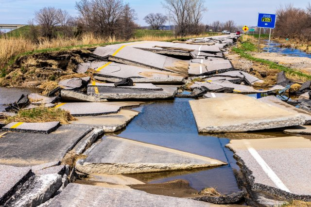image of broken pavement from Iowa floods