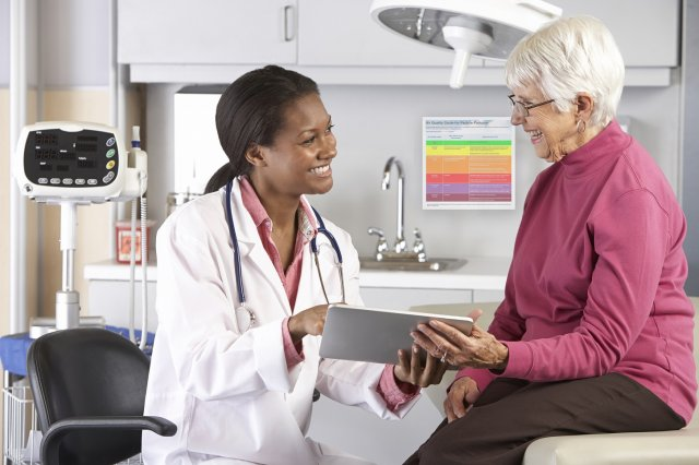 Doctor counseling patient in doctor's office setting