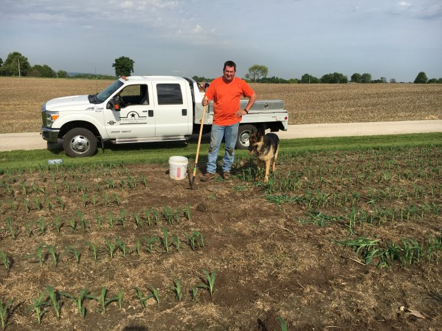 steve ehrler and his dog tend to the farm