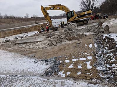Photo of A portion of the concrete channel that lines the Rouge River is removed in order to reconnect the Rouge Oxbow.