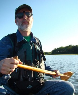 Walter Berry in a canoe on his way to count sparrows on the salt marsh.