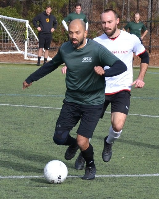 Mehdi Hazari playing soccer.
