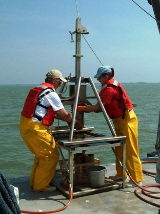 Tammy with Walter Boynton collecting sediment cores to assess the health of the Chesapeake Bay.